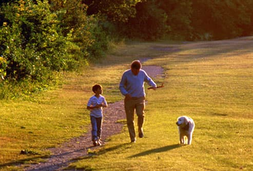 Man and grandson walking the dog