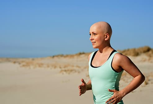 woman with cancer excercising