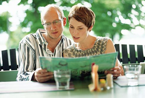 Couple looking at menu in restaurant