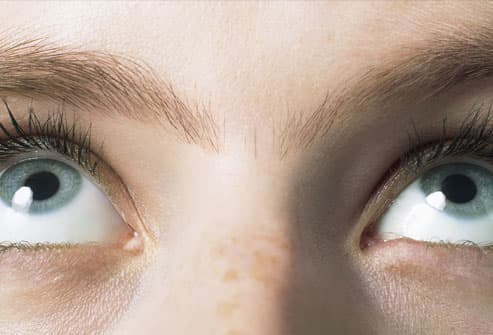 Woman Looking at Her Monobrow