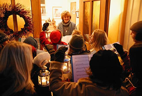Holiday carolers singing for neighbor