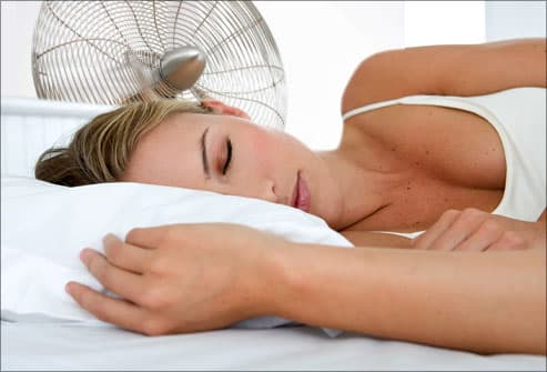Woman sleeping with electric fan