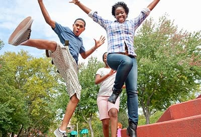 teens jumping in park