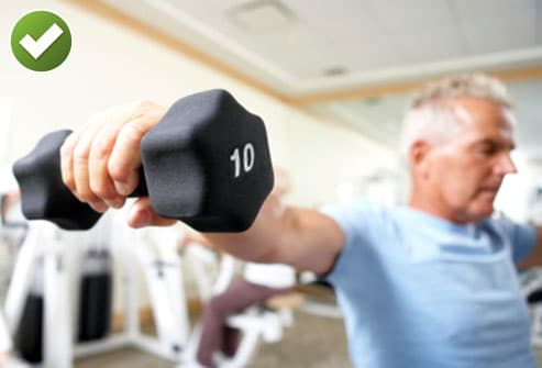 Man Lifting Weight in Gym