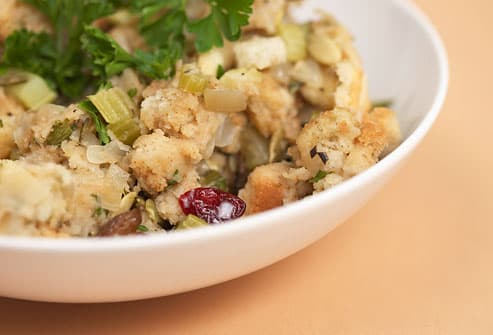 Bowl of stuffing topped with fresh parsley