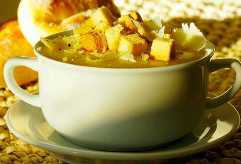 Cup of hearty soup with croutons