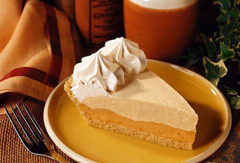 Slice of Pumpkin Mousse Pie with Cinnamon Cream