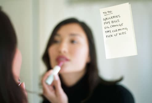 To-do list stuck to woman's bathroom mirror