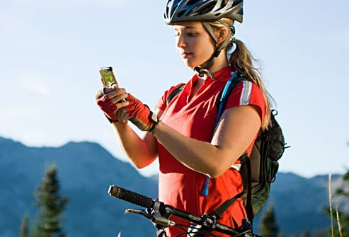 woman using phone to track bike ride