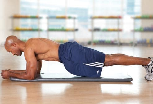man doing front plank
