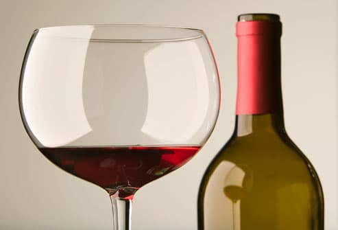 Red wine in glass with bottle, close up