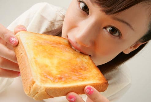girl snacking on toast