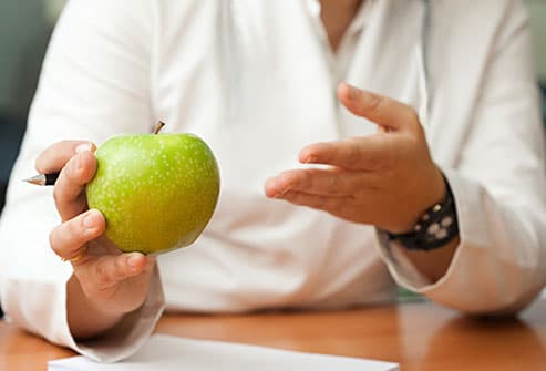 nutritionist with apple