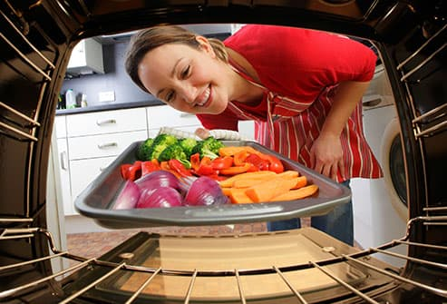 woman roasting vegetables