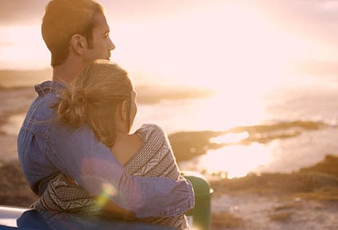couple hugging by ocean view