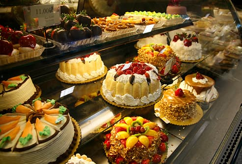 Cakes and desserts in bakery showcase