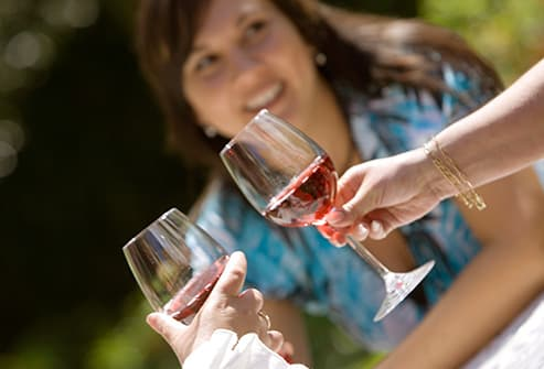 women drinking wine outdoors