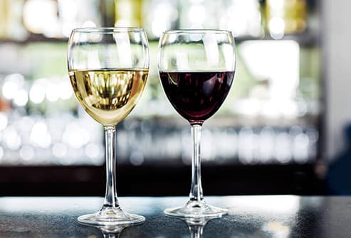 glasses of white and red wine in tavern