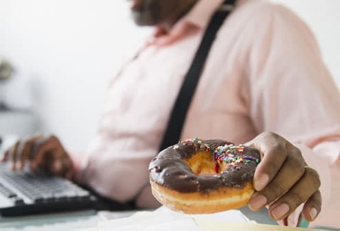 Man about to eat fattening doughnut