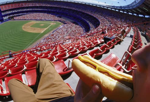 Man eating hot dog at stadium