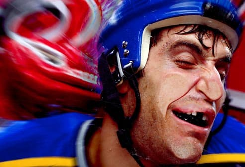 hockey player smashing into barrier