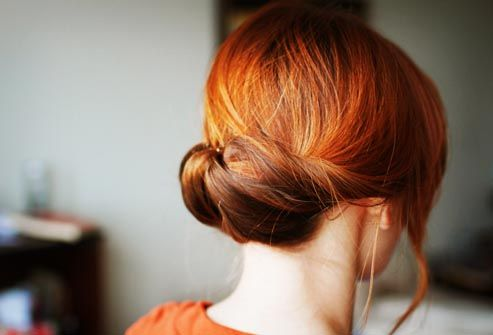 woman with red hair in bun