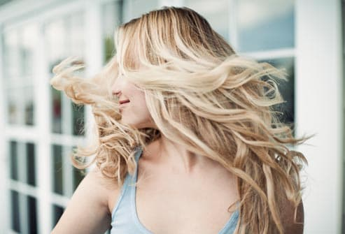woman shaking her blonde hair