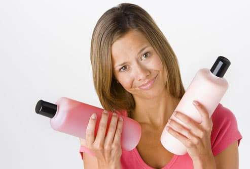 Woman Holding Hair Styling Products