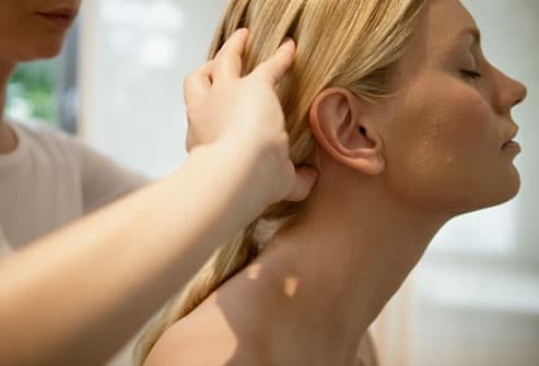 Woman receiving tension headache massage