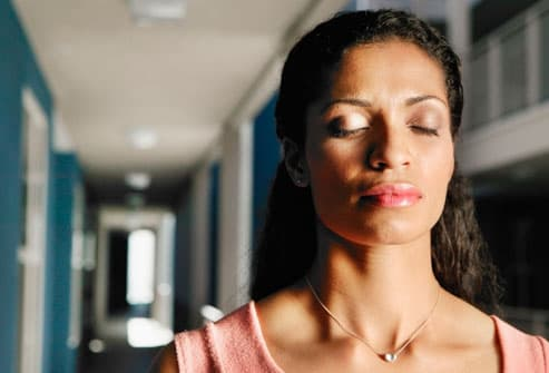 Woman breathing for headache relief
