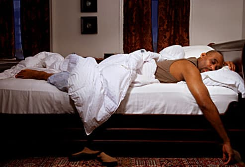 Man sleeping soundly in comfy looking bedroom