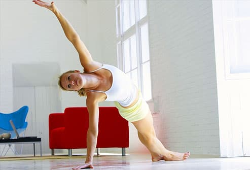 Woman stretching in her livingroom