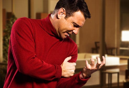 getty rf photo of man having heart attack. - 10 Visual Guide to a Heart Attack By Webmd