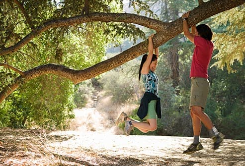 couple hanging from tree