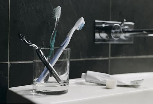 Toothbrushes and Razor By SInk