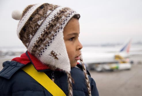 child wearing winter hat at airport