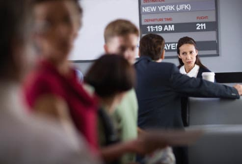 impatient people in line at airport