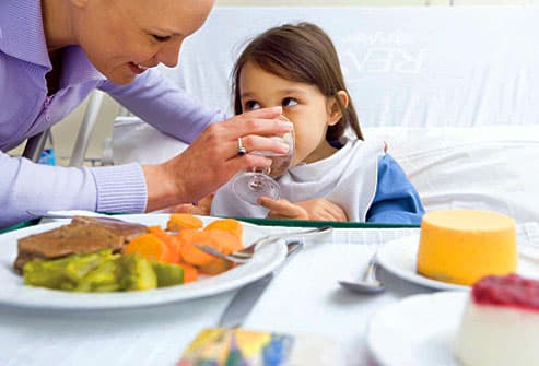 Mom assisting daughter with a hospital meal