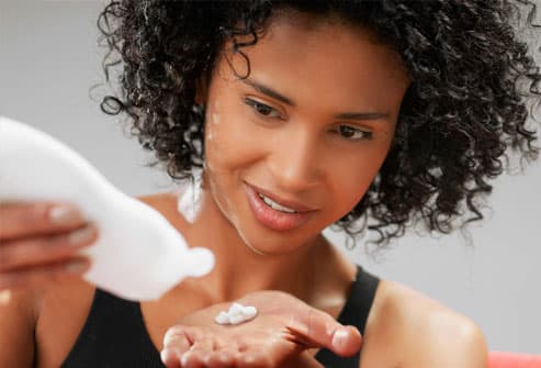Woman dispensing small dab of face cleanser