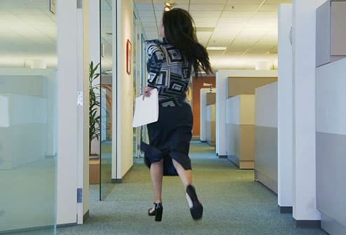 Woman running through office