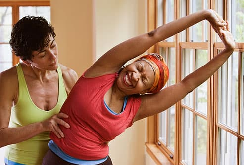 How does exercise assist in reducing the blood sugar level?