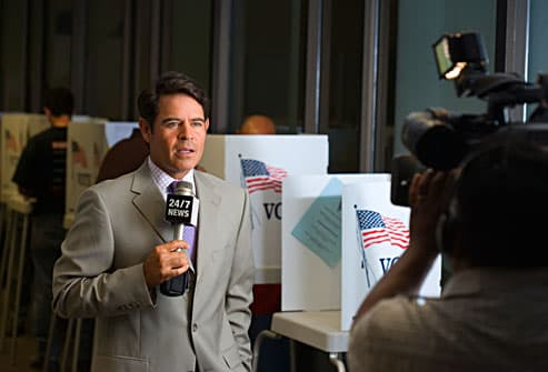 Cable reporter covering late night election result
