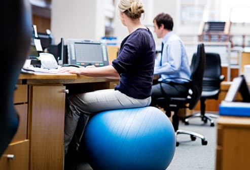 Woman Maintaining Good Posture at Work