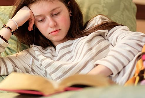 teen reading before bed