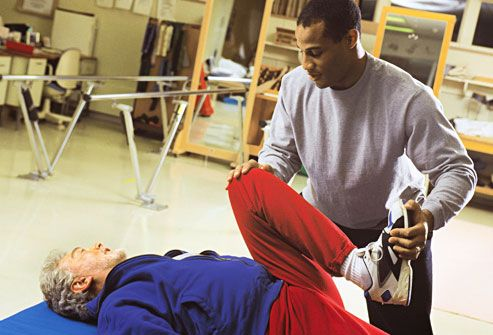 woman working with physical therapist