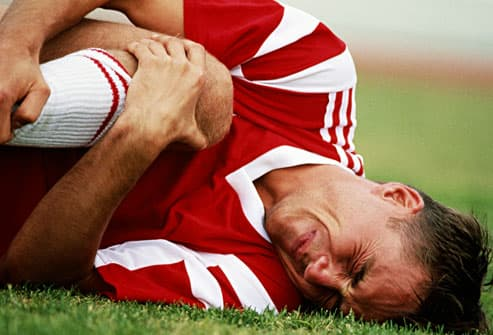 soccer player with injured knee