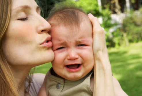 Mother calming crying baby