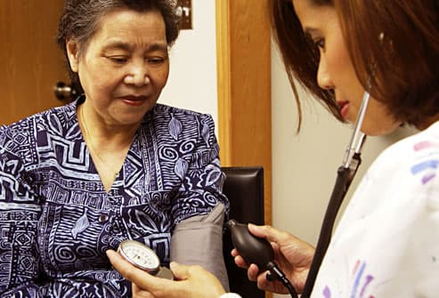 woman having her blood pressure checked