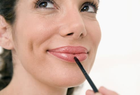 Woman Plumping Lips