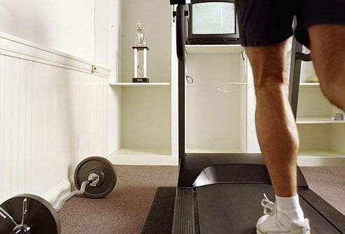 Man Working Out in Gym Room at Home